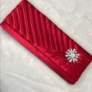 Clutch red with daimond flower on side satin fabri